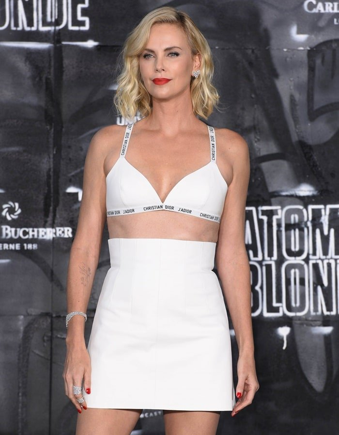 Charlize Theron looked super sexy in a white bra and high-waisted skirt from Dior at the world premiere of her movie 'Atomic Blonde' at Potsdamer Square in Berlin, Germany, on July 17, 2017
