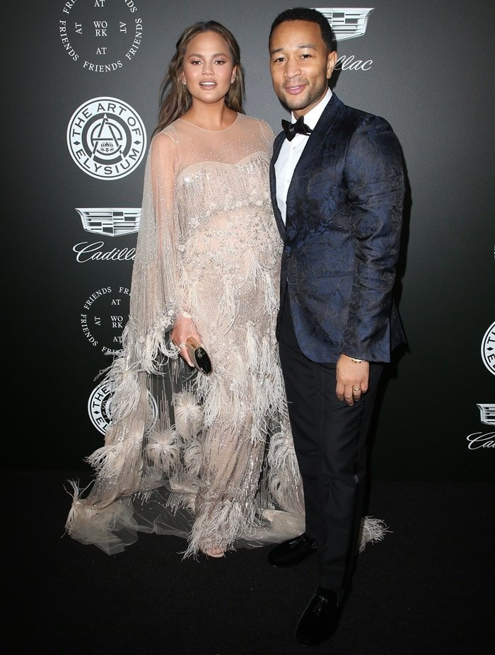 John Legend and his wife Chrissy Teigen at the 2018 Art of Elysium Heaven Gala in Santa Monica, California, on January 6, 2018