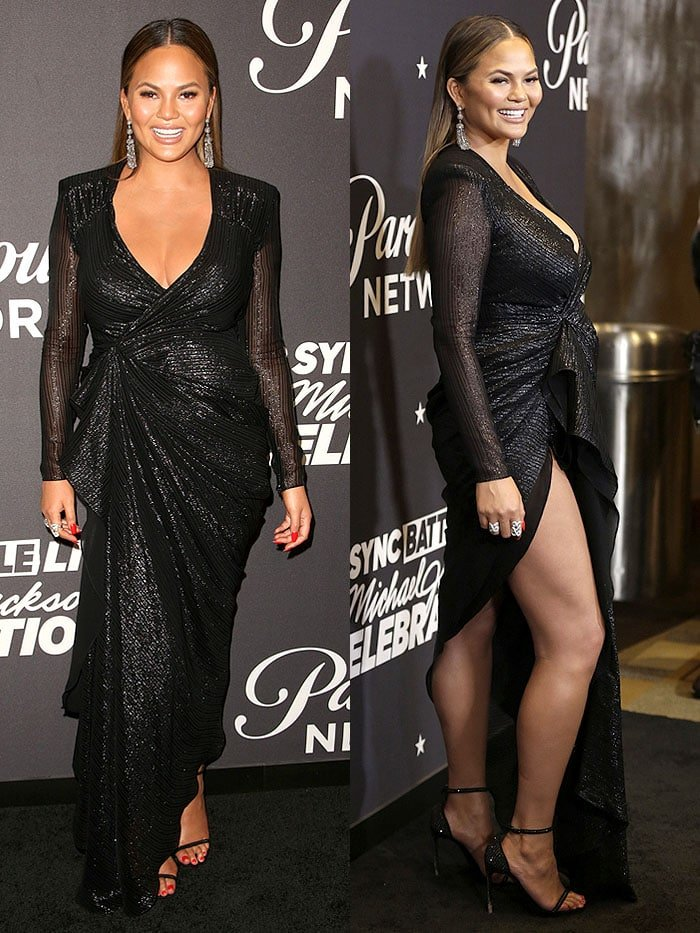 Chrissy Teigen stunned in a sparkly black Reformation wrap gown that showed plenty of cleavage and leg thanks to its deep v-neck and thigh-high slit