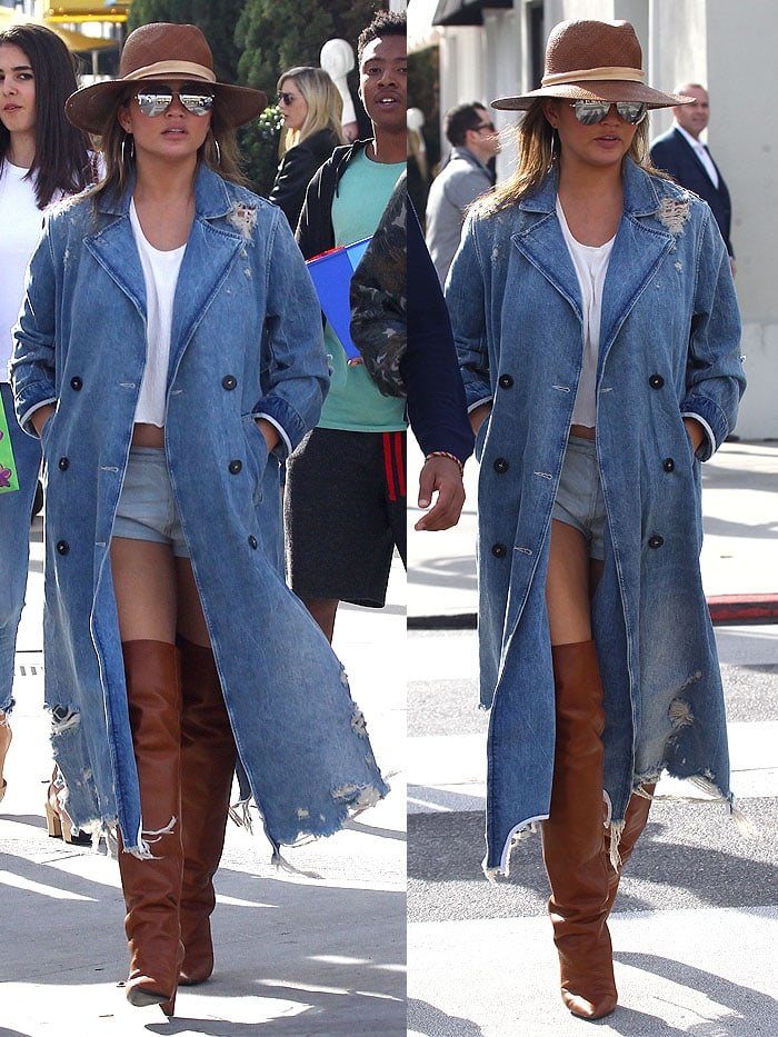 Chrissy Teigen covered up in an Alexander Wang tattered denim trench coat