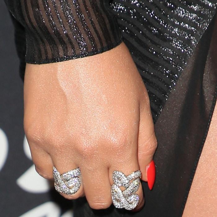 Chrissy Teigen showing off her rings