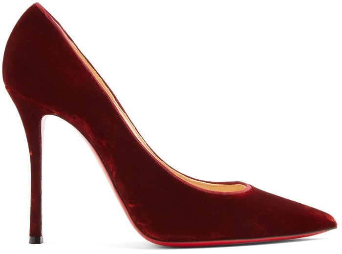 Christian Louboutin's burgundy velvet 'Decoltish' pumps are crafted in Italy with a sharp point toe and sultry curved high stiletto heel