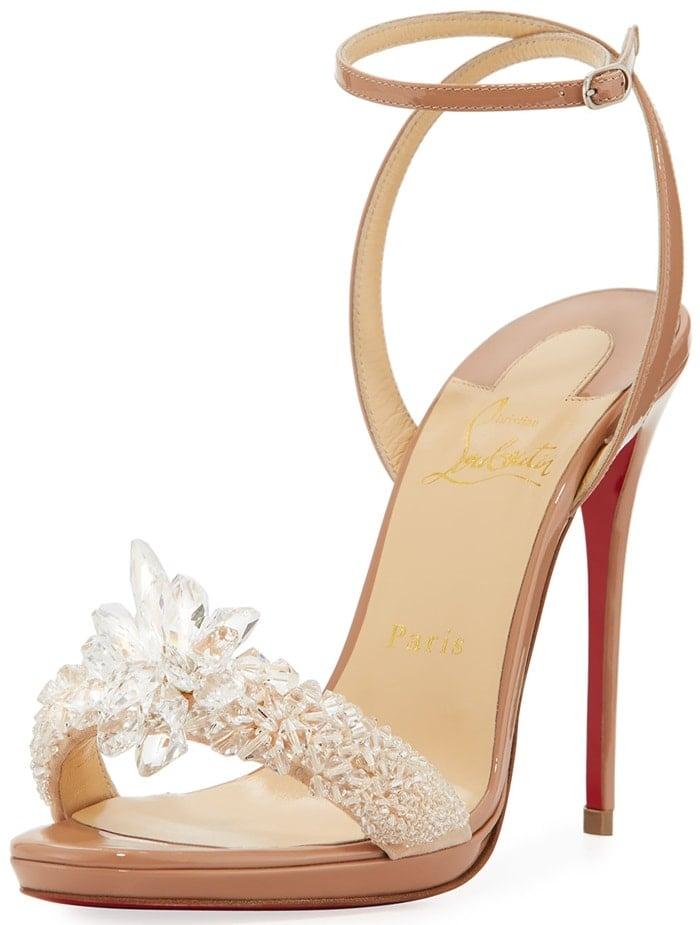 This slender platform sandal is encrusted in dazzling crystal shards of varying sizes