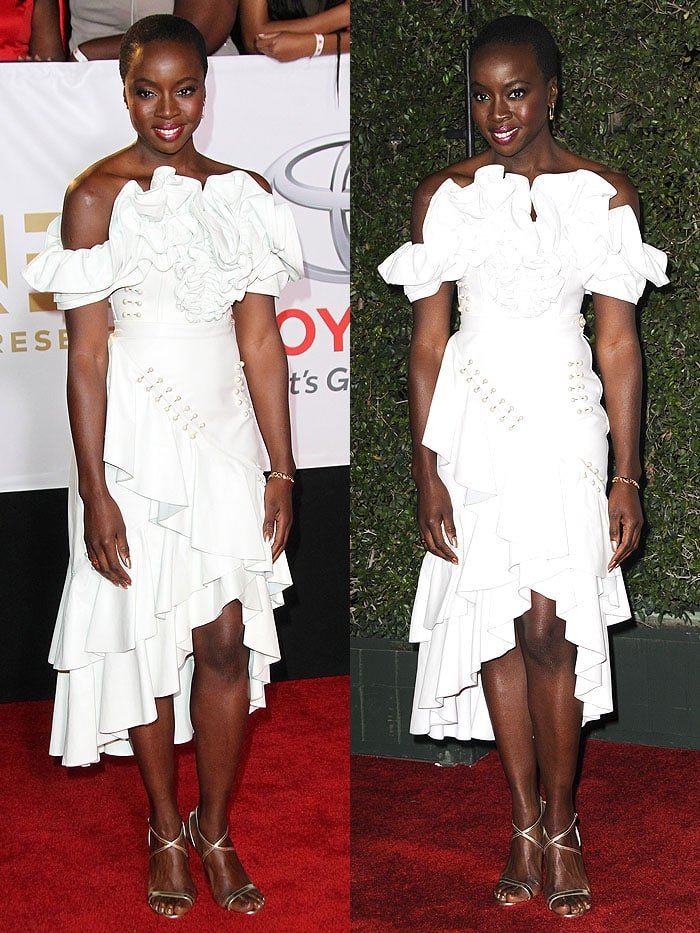 Danai Gurira in a white Rodarte off-shoulder dress with a riot of ruffles at the neckline and the asymmetrical hem