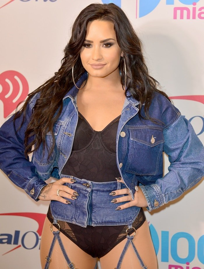 Demi Lovato in revealing chaps attends the 2017 Y100 Jingle Ball at BB&T Center on December 17, 2017 in Sunrise, Florida