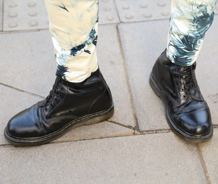 Model showing off his laced Doc Martens during London Fashion Week on January 6, 2018
