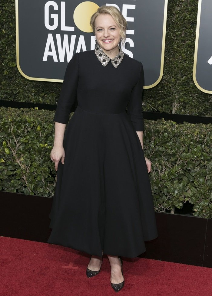 Elisabeth Moss accessorized with Forevermark jewels, a Roger Vivier clutch, and glittering Christian Louboutin pointy-toe lace pumps