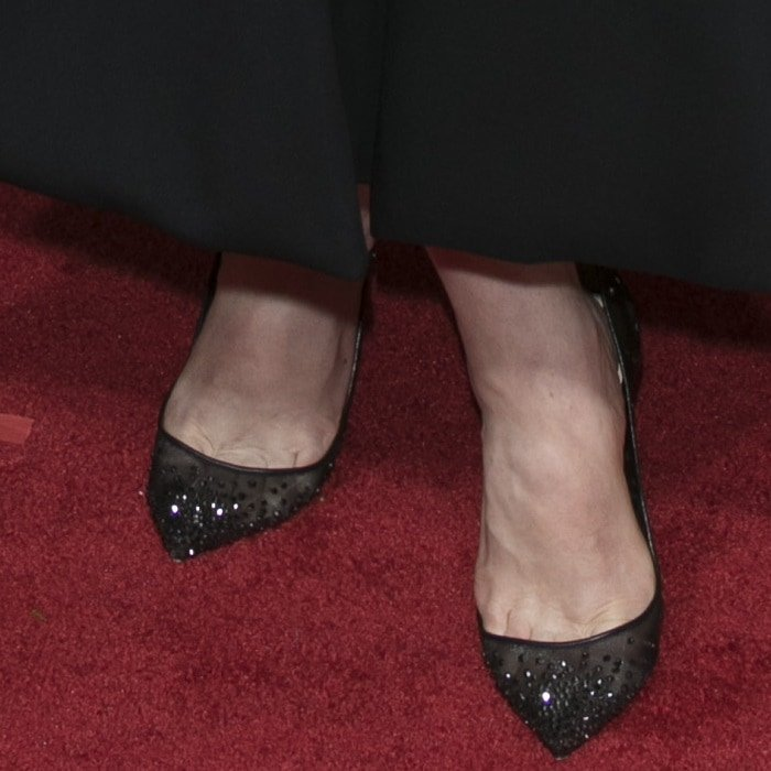 Elisabeth Moss rocking pointy-toe pumps from Christian Louboutin