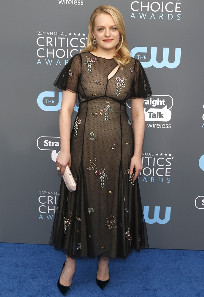 Elisabeth Moss wearing an extremely unflattering dress from the Erdem Pre-Fall 2018 dress at the 2018 Critics' Choice Awards at The Barker Hangar in Santa Monica, California, on January 11, 2018