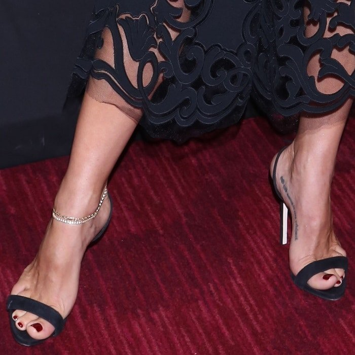 Elsa Pataky showing off her ankle bracelet and black sandals