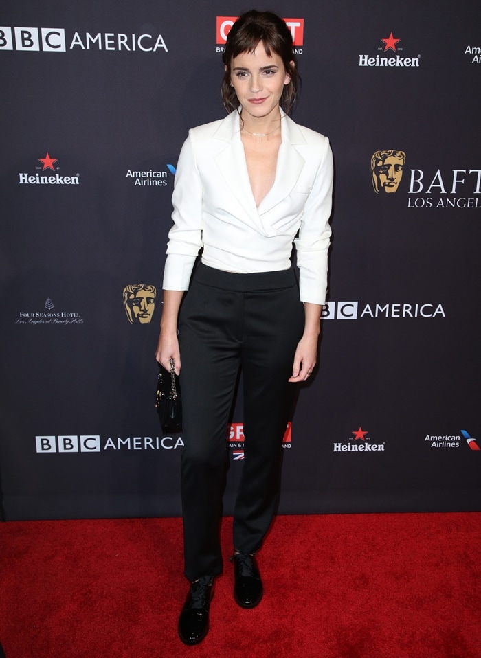 Emma Watson arrived at the Heineken-sponsored event in a white jacket and black pants designed by Osman
