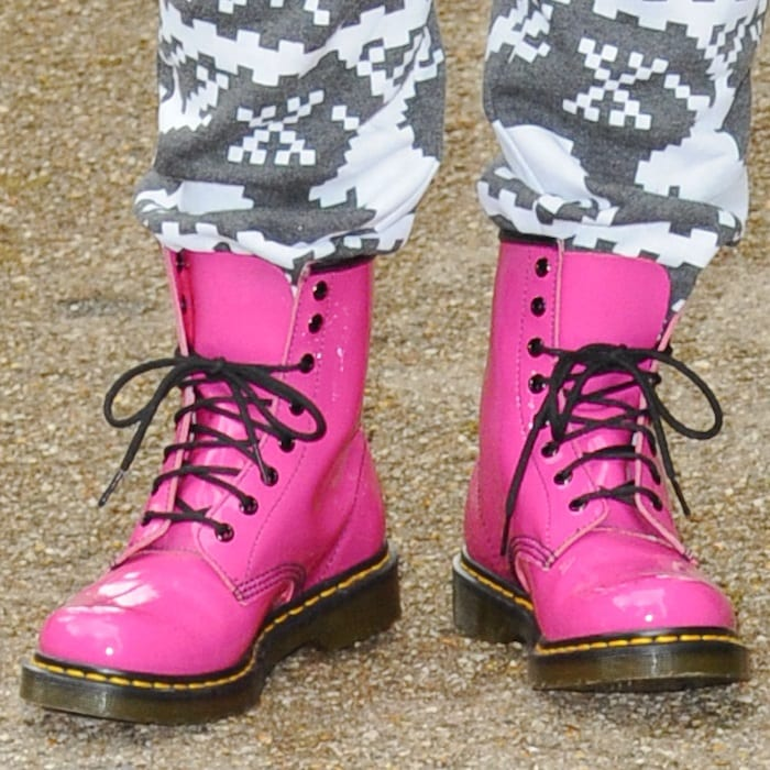 British singer-songwriter Gabz Gardiner showing off her pink boots with laces through the lower six eyelets at the ITV studios in London on July 3, 2013