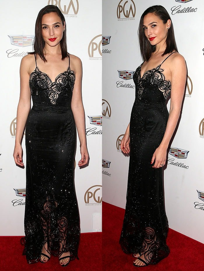 Gal Gadot in a black custom Armani Prive gown that featured swirly sheer panels and a smattering of sparkly crystal embellishments