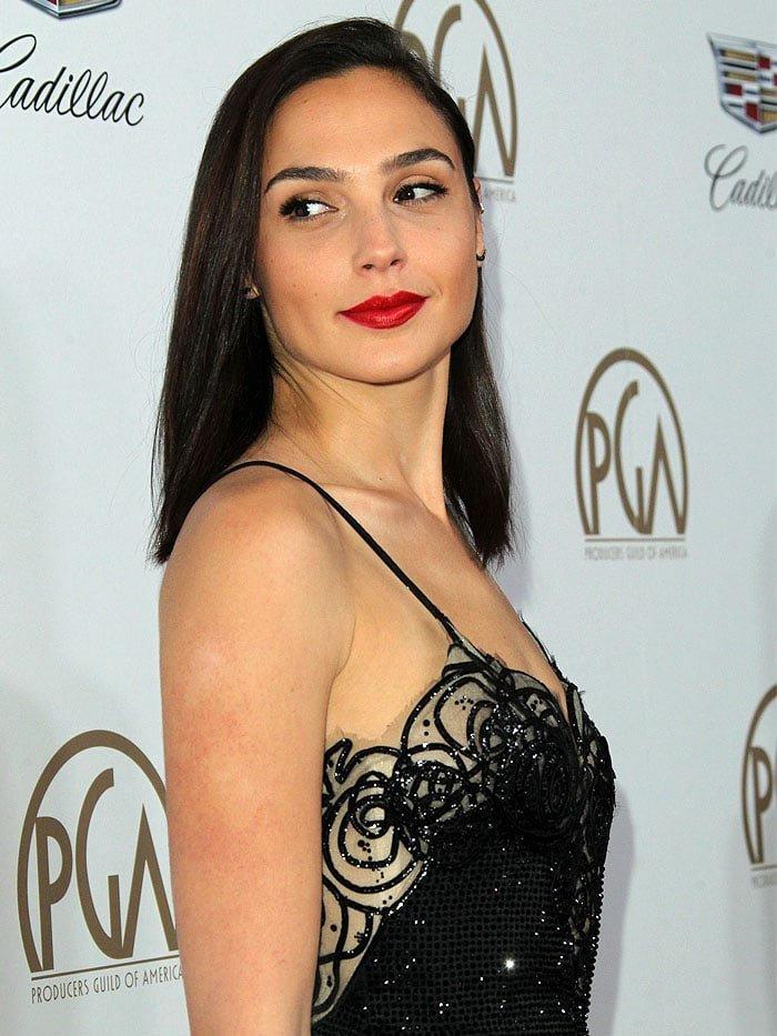 With swipes of bold red on her lips and nails and with her shoulder-length hair worn down, Gal exuded sexy elegance