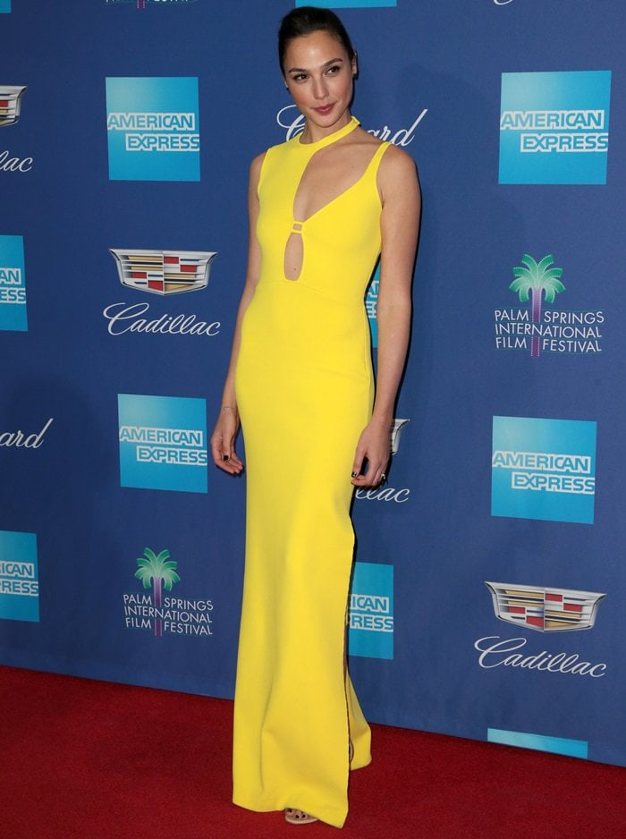 Gal Gadot wearing a yellow knit dress with cutout detailing at the 2018 Palm Springs International Film Festival Awards Gala on Tuesday in Palm Springs, California, on January 2, 2018