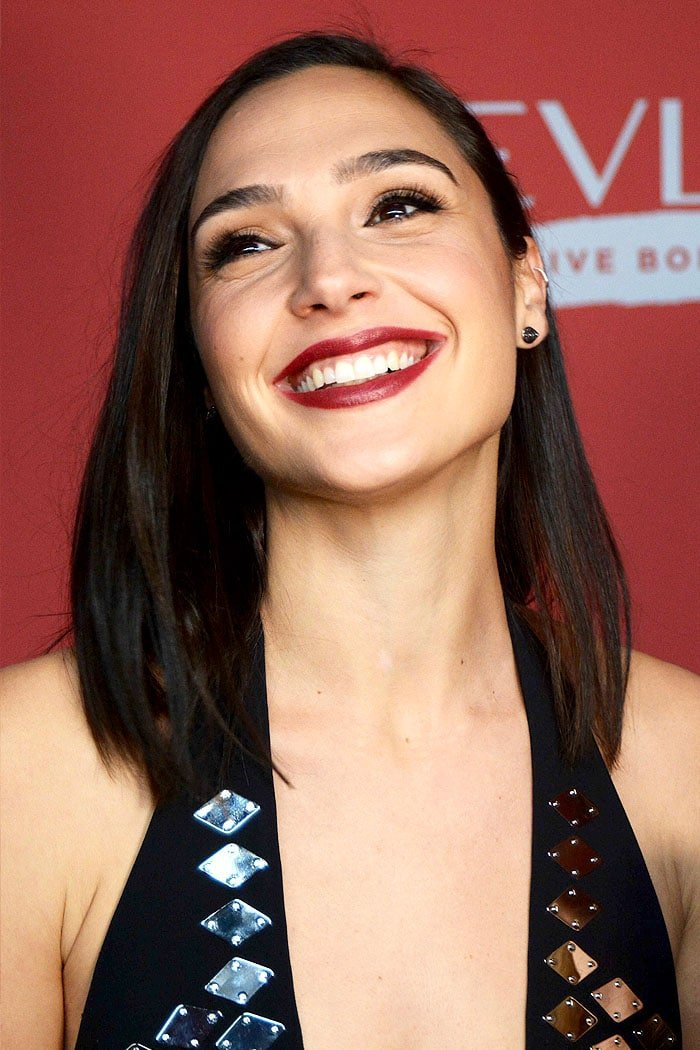 Gal Gadot sported striking berry lips and flashed her beautiful smile.