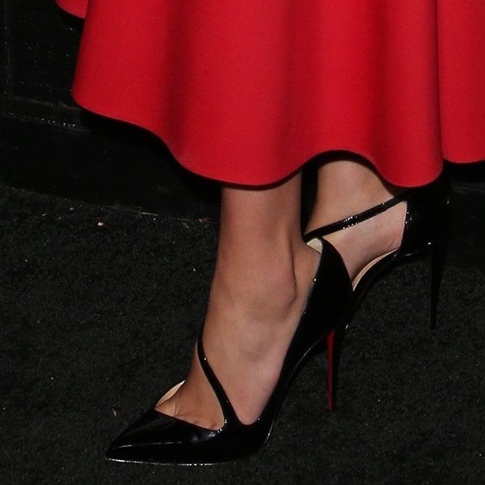 Gal Gadot's hot feet in black patent Christian Louboutin pumps