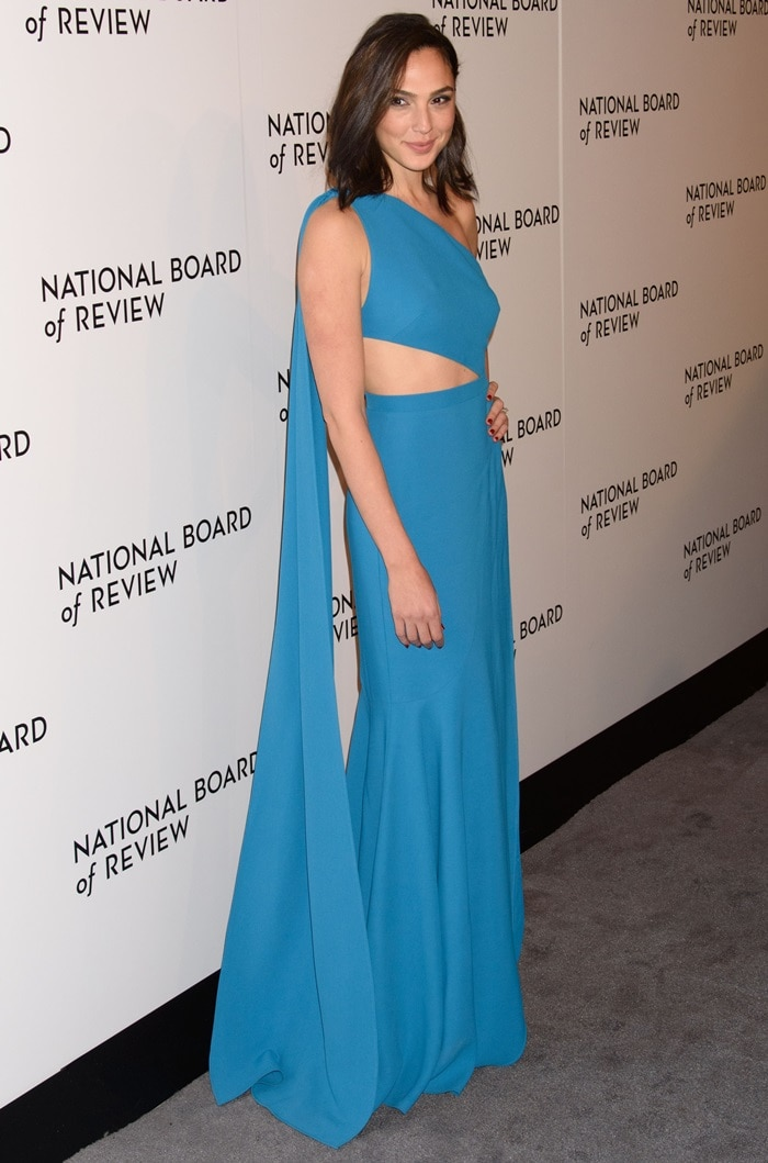 Gal Gadot wearing a one shoulder gown from the Elie Saab Spring 2018 collection at the 2018 National Board of Review Awards Gala at Cipriani 42nd Street in New York City on January 9, 2018