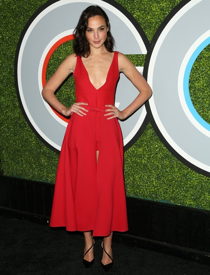 Gal Gadot in a red Christian Dior dress styled with black Christian Louboutin heels