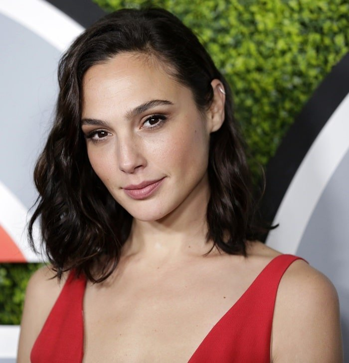 Gal Gadot strikes a pose as she arrives in a red Dior dress at the 2017 GQ Men of the Year Dinner hosted by GQ and Dior Homme at the Chateau Marmont in Los Angeles on December 7, 2017
