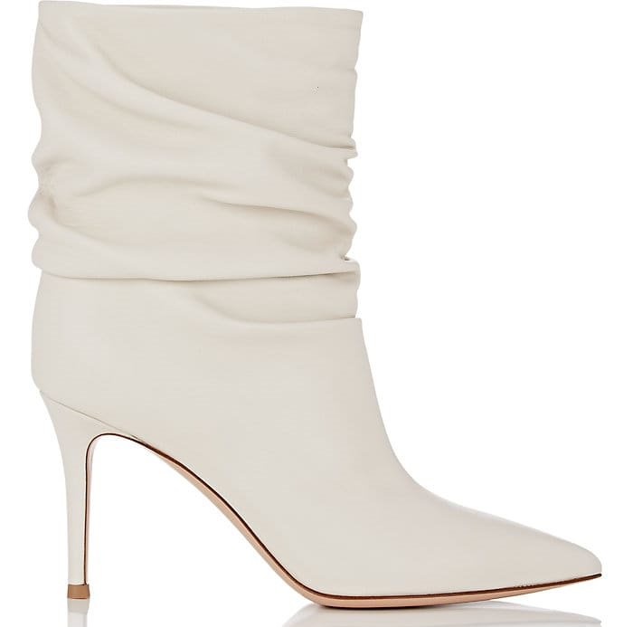 Gianvito Rossi's off-white nappa leather 'Cecile' ankle boots feature a pointed toe and leg-lengthening stiletto heel