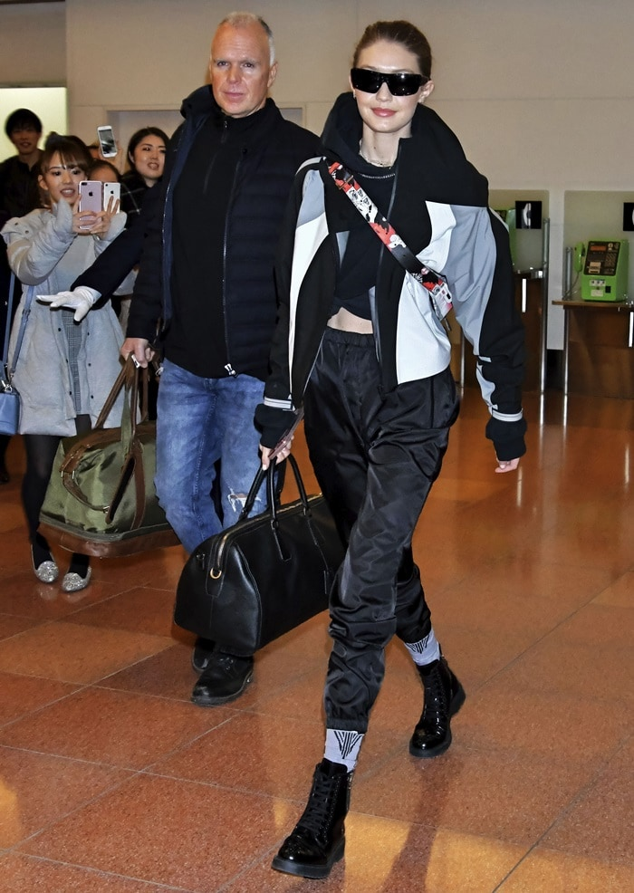 Gigi Hadid was spotted landing at Tokyo International Airport in head-to-toe Prada on Thursday in Tokyo, Japan, on January 25, 2018