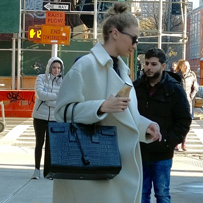 Gigi Hadid leaving her apartment in a winter white overcoat in New York City on January 10, 2018
