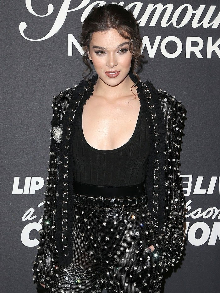 Hailee Steinfeld a black bodysuit with high-cut bottoms that were exposed through her ensemble's sheer fabric