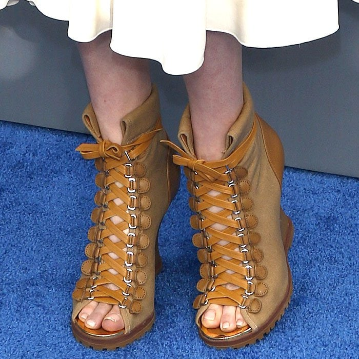 Closeup of Haley Bennett's Chloe 'River' lace-up open-toe wedge booties.
