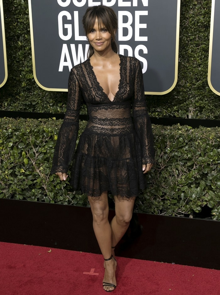 Halle Berry showing off her incredible figure in a sheer lacy black minidress from Zuhair Murad's Spring 2018 collection