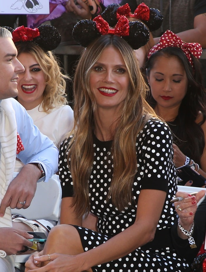 Heidi Klum in a polka-dot knit sweater from Michael Kors paired with a matching sequin-dotted pencil skirt