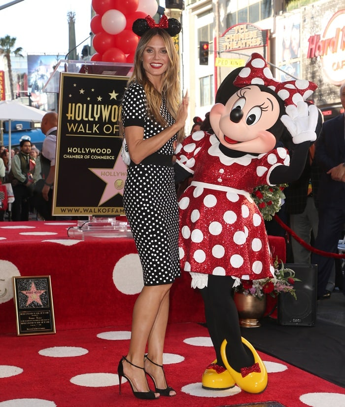 Heidi Klum poses for some photos with Minnie Mouse at the Hollywood Walk of Fame ceremony celebrating the 90th anniversary of the Disney character in Hollywood on January 22, 2018
