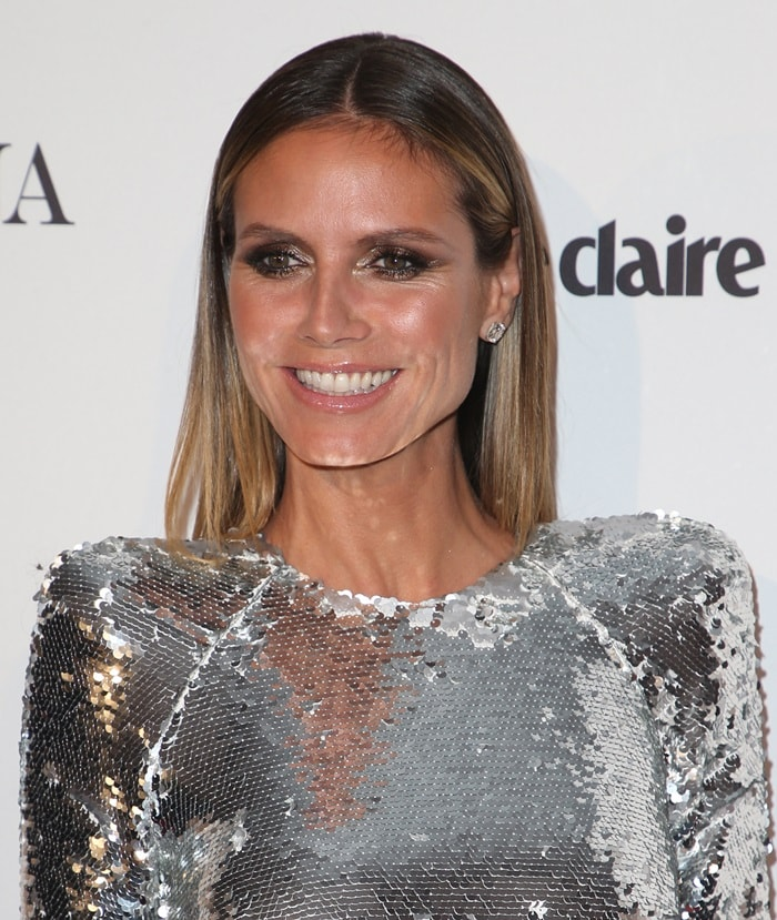 Heidi Klum wearing a metallic silver-tone 'Dalston' dress from Alex Perry at the 2018 Marie Claire's Image Makers Awards in Los Angeles on January 11, 2018