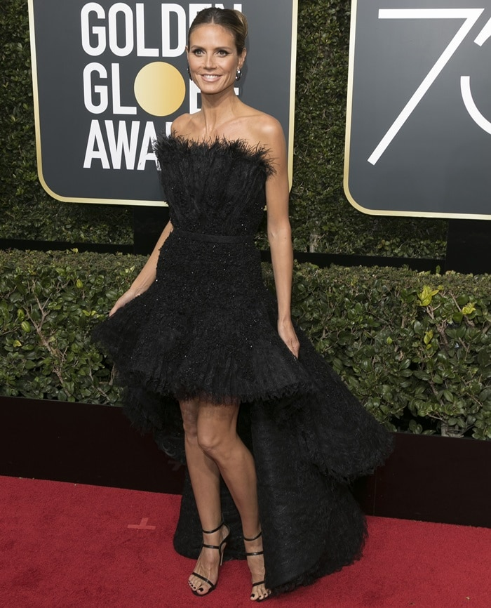 Heidi Klum wearing a black feather dress from the Ashi Studio Fall 2017 Couture collection at the 2018 Golden Globe Awards held at the Beverly Hilton Hotel in Beverly Hills, California, on January 7, 2018