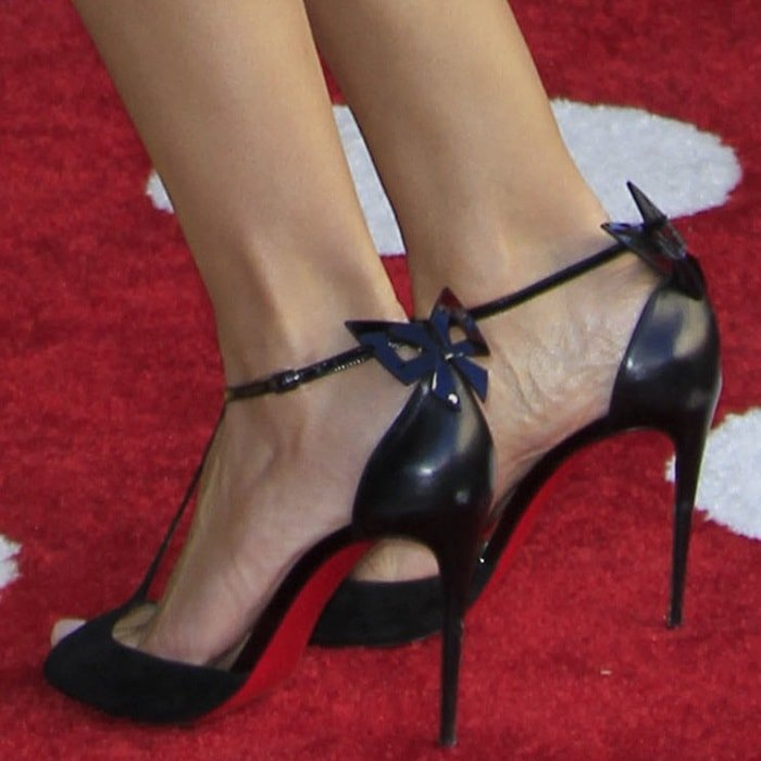Heidi Klum's hot feet in Christian Louboutin Aribak 100 bow-embellished leather and suede T-bar sandals