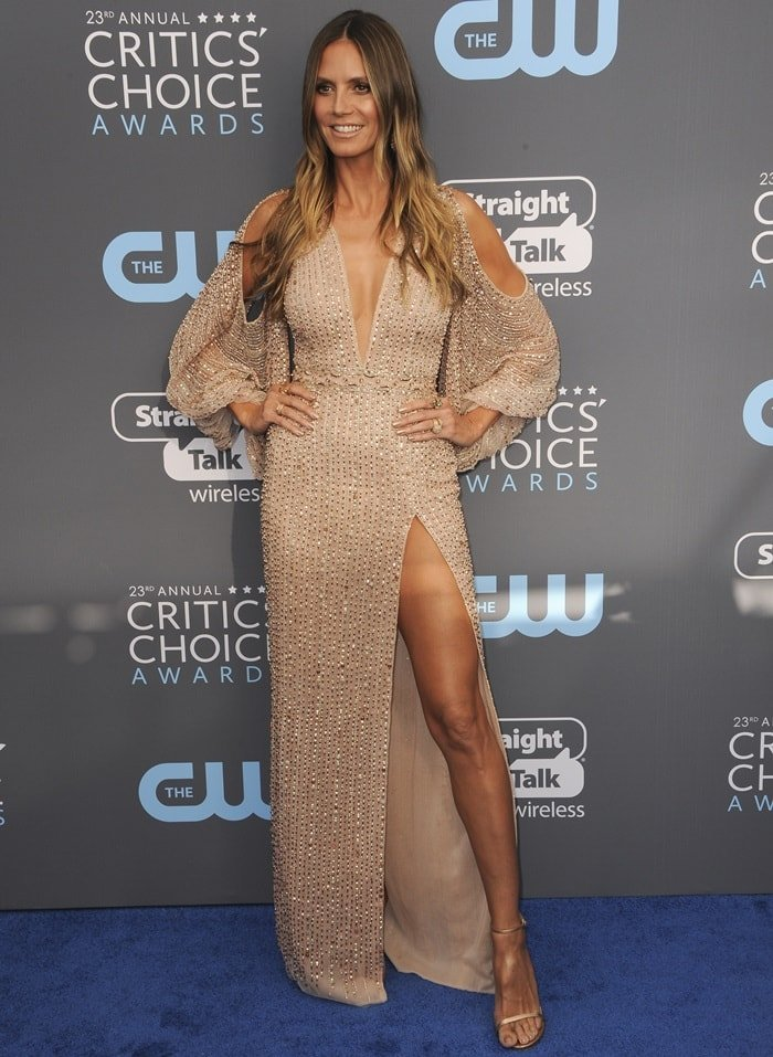 Heidi Klum flashes a smile in a Georges Hobeika Couture Fall 2017 dress on the blue carpet at the 2018 Critics' Choice Awards held at The Barker Hangar in Santa Monica, California, on January 11, 2018