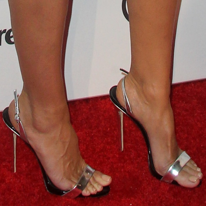 Heidi Klum wearing silver 'Sophie' sling-back sandals from Giuseppe Zanotti