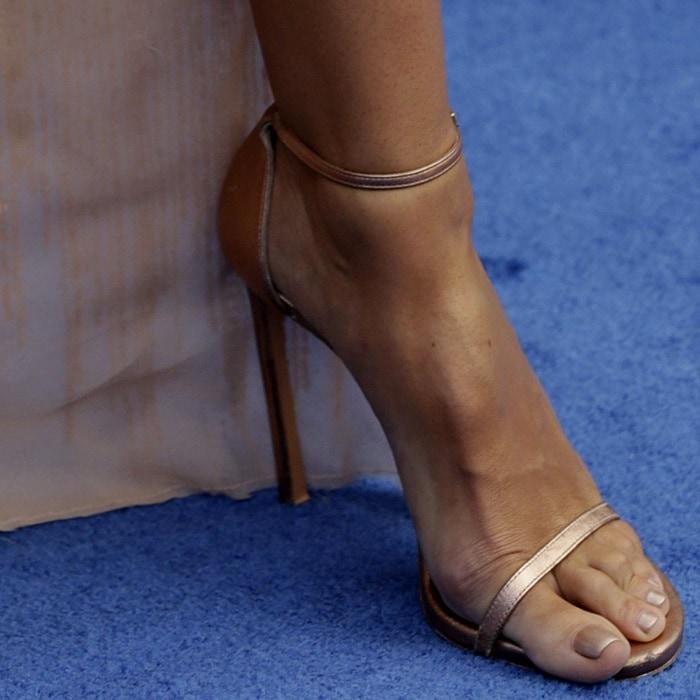 Heidi Klum with crazy toe overhang in 'Nudist' ankle-strap heels from Stuart Weitzman