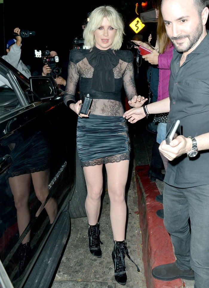 Ireland Baldwin showed off her statuesque frame in black satin 'Kamilya' lace-up booties