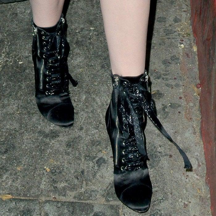Ireland Baldwin wearing black satin 'Kamilya' lace-up booties from Giuseppe Zanotti