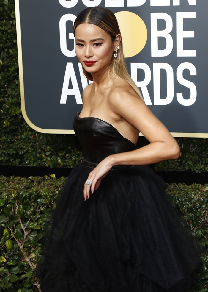 Jamie Chung wearing an Ermanno Scervino tulle high-low dress at the 2018 Golden Globe Awards held at the Beverly Hilton Hotel in Beverly Hills, California, on January 7, 2018