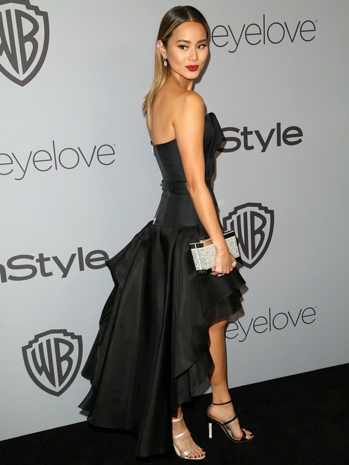 Jamie Chung rocking a black a strapless prom-style dress with layered skirt at the InStyle and Warner Bros. Party held after the 2018 Golden Globe Awards at the Beverly Hilton Hotel in Beverly Hills, California, on January 7, 2018