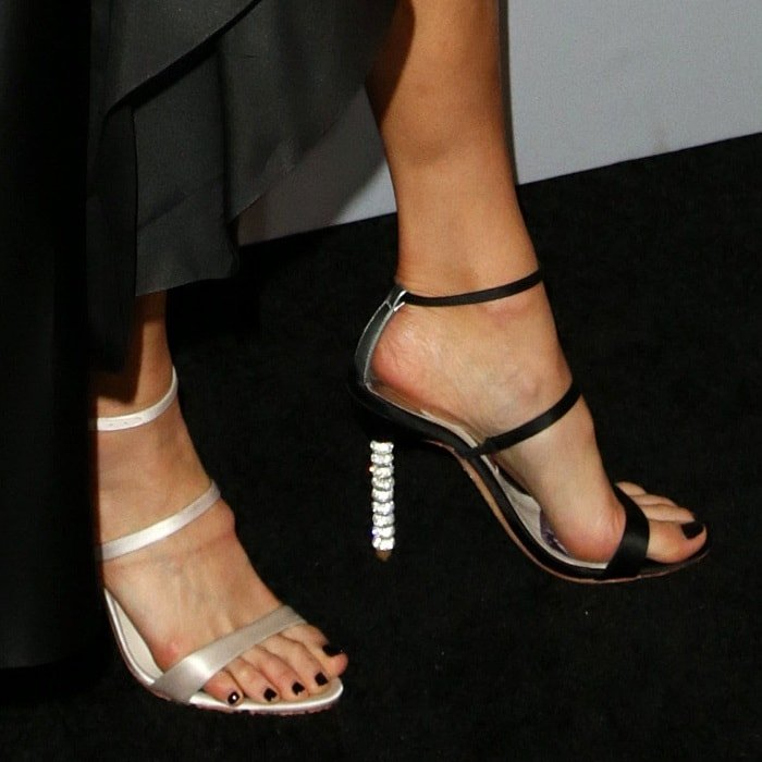 Jamie Chung showing off her feet in mismatched heels by Sophia Webster