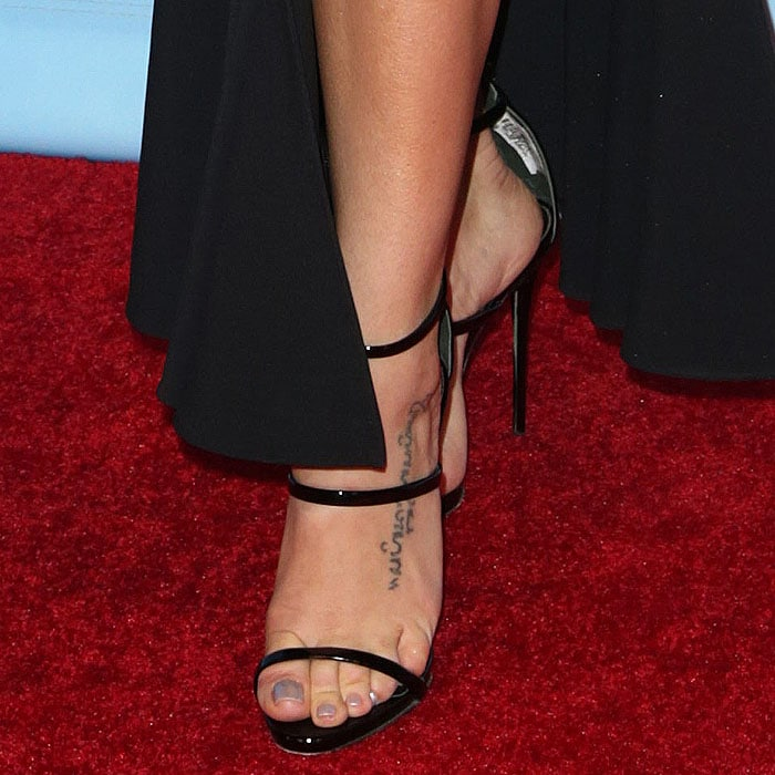 Jenna Dewan Tatum's toes look to be in absolute pain thanks to the steeply-pitched stilettos