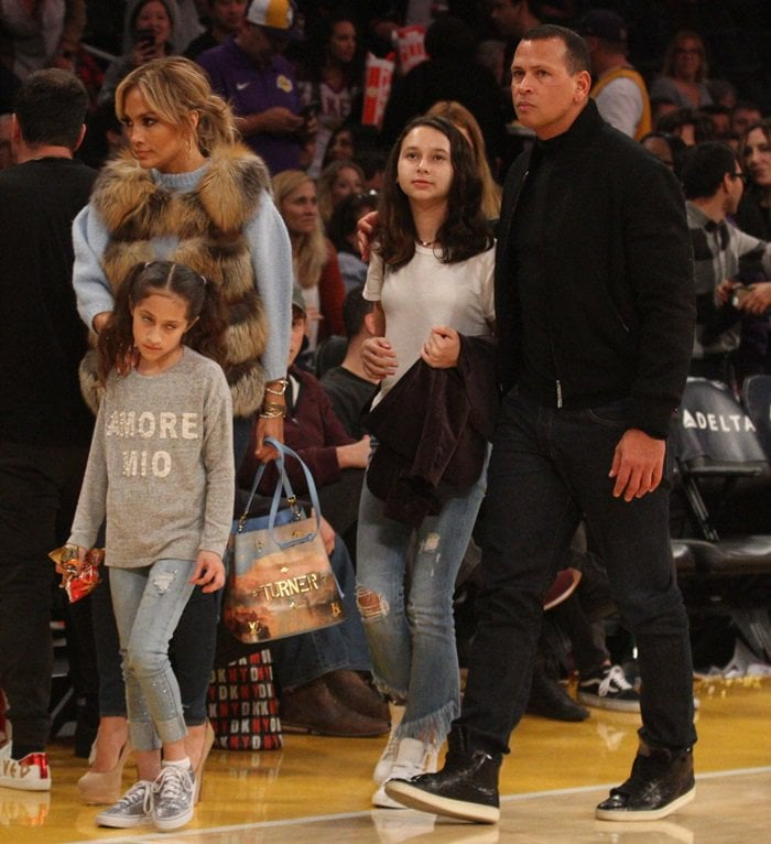 "Jennifer Lopez carries a 'Turner NeoNoe' canvas bag from the Louis Vuitton x Jeff Koons ""Masters"" collaboration"