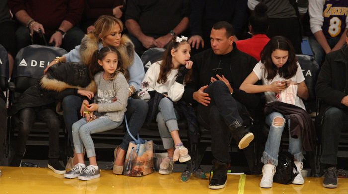 Jennifer Lopez watches the Los Angles Lakers game along with her twins Emme and Maximilian and Alex Rodriguez with his daughters Ella and Natasha