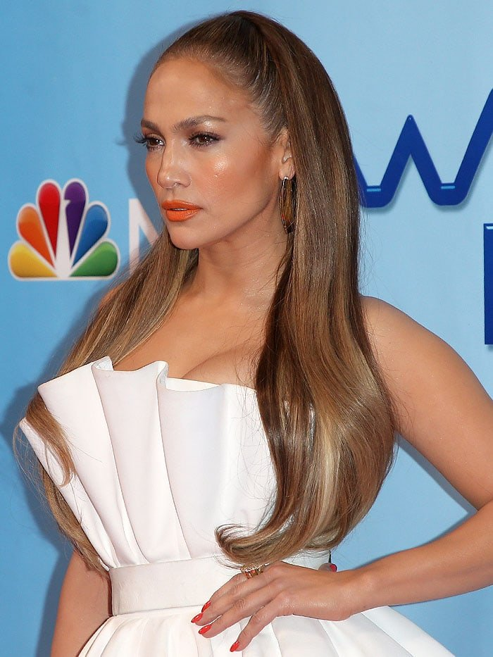 Jennifer Lopez pulled her straight brunette tresses into a scraped-back ponytail