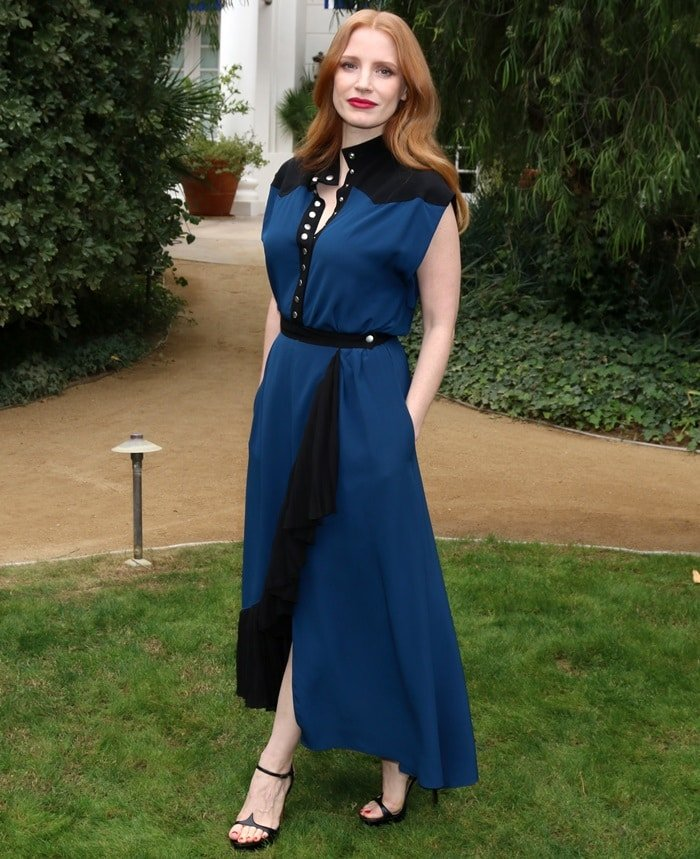 Jessica Chastain in a sleeveless black & navy dress from Givenchy paired with another pair of black sandals