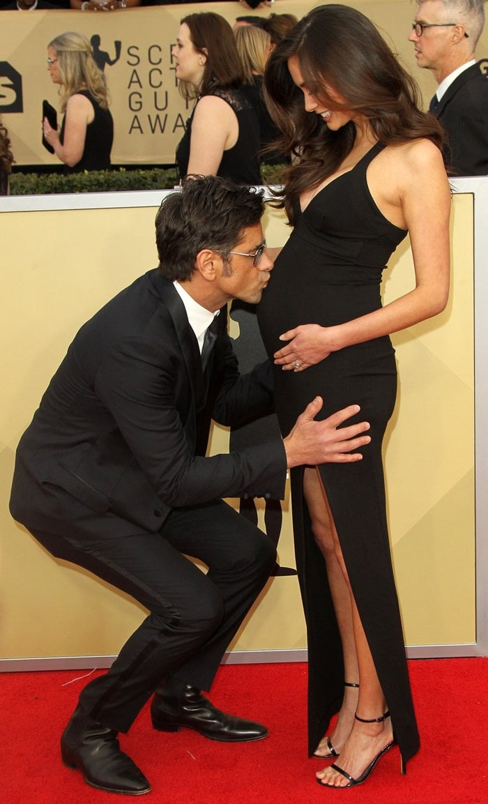 John Stamos took the opportunity to bend down to kiss his fiancée's protruding belly
