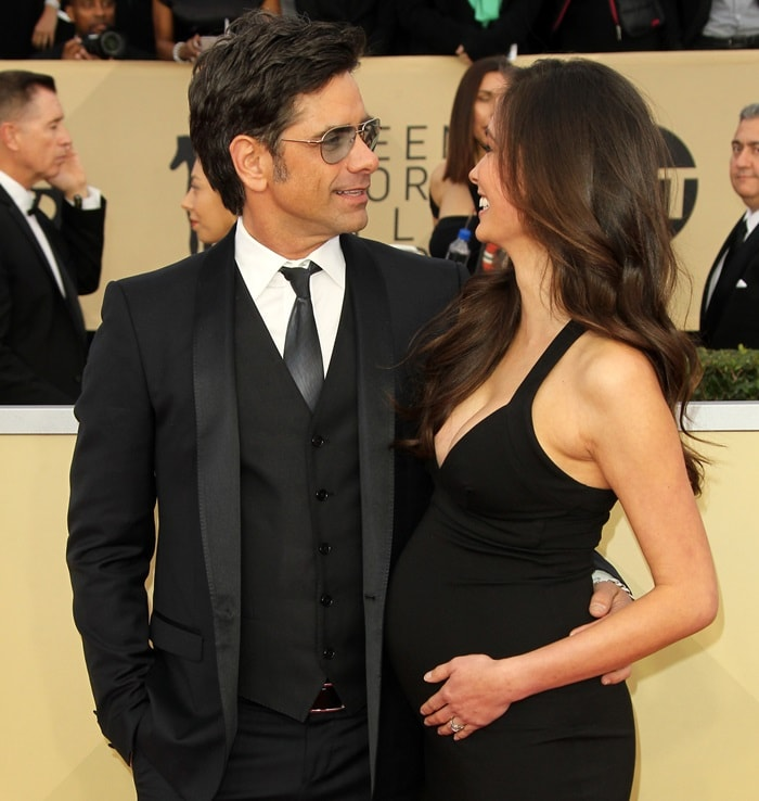 John Stamos and his pregnant fiancée Caitlin McHugh looked so in love at the 2018 Screen Actors Guild Awards at the Shrine Auditorium in Los Angeles on January 21, 2018